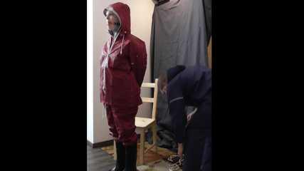 Lady Nadja in layers of AGU rainwear bound and gagged by a stranger