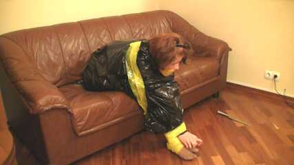 [From archive] Stella - taped sitting with yellow duct tape and packed into trash bag (video)