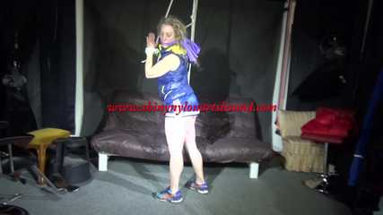 Sexy Sophie being tied and gagged overhead with ropes and a clothgag wearing a sexy oldschool shiny nylon shorts and a blue down vest (Video)