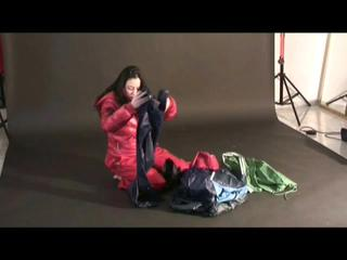 Blackhaired archive girl posing in sexy shiny nylon rainwear (Video)