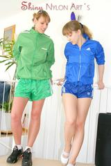 Leonie and Lea wearing sexy shiny nylon shorts and rain jackets while having fun with eachother on a stairway (Pics)