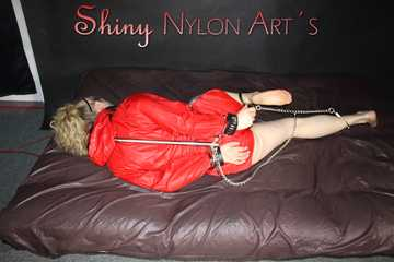 Watching sexy Sophie wearing a red shiny nylon shorts and a shiny red rain jacket being tied and gagged with cuffs, a bar and a clothgag Part 2 of 2 (Pics)