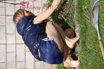 Sexy Sandra wearing a sexy darkblue shiny nylon shorts and a blue downvest during her gardening work Part 2 (Pics)