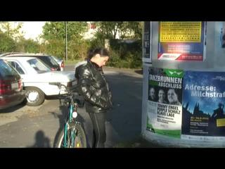 Enni riding the bicycle wearing a sexy shiny nylon shorts beneath the jeans and a downjacket on naked skin (Video)