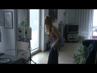 Sophie emptying the dishwasher wearing sexy shiny nylon rainwear (Video)