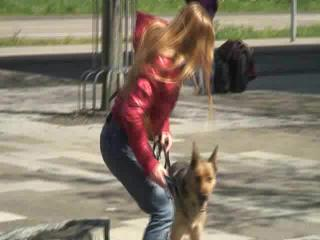 Katharina take a walk with her dog wearing a sexy red shiny down jacket (Video)