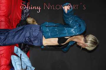 Watching Sonja wearing sexy shiny nylon rain pants and a sexy shiny nylon down jacket changing clothes (Pics)