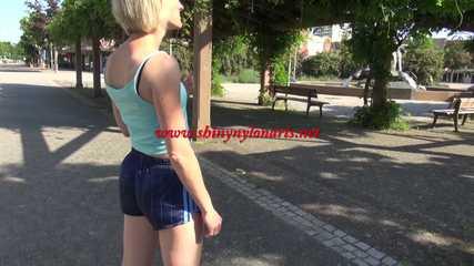 Watching SEXY SONJA walking through the city wearimg a blue shiny nylon shorts and tshirt (Video)