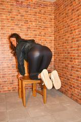 Sexy archive girl posing on a chair wearing supersexy shiny nylon rainwear (Pics)