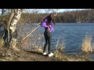 Alina walking in a lake wearing a supersexy purple down jacket and a jeans (Video)