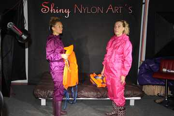 Watching Sandra and Sophie wearing sexy shiny nylon rainwear and helping eachother putting on the lifevests the other way round (Pics)