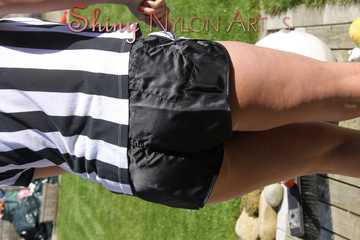 Watching Pia sweeping the terrace wearing a sexy black shiny nylon shorts, a striped top and black rubber boots (Pics)
