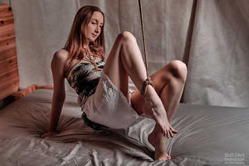 Seductive jute tied ankle in black and white clothes