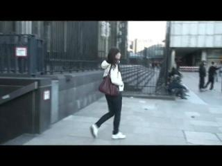 Alina walking on the street wearing a supersexy white down jacket and a jeans (Video)
