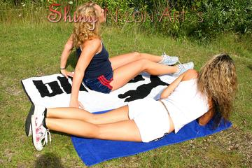 Petra and Sophie sun bathing wearing sexy shiny nylon shorts and a top (Pics)