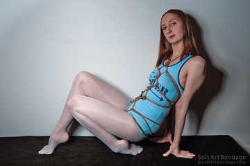 Karada in blue shirt and white pantyhose legs