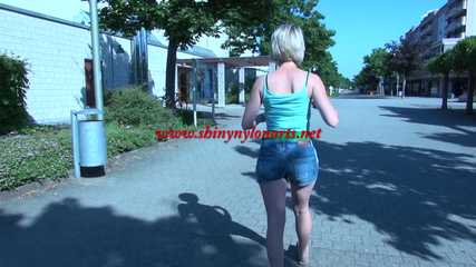 SEXY ***SONJA*** wearing a sexy green shiny nylon shorts under her Jeans walking through the city  (Video)