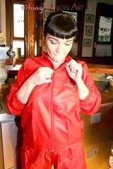 Jill posing sexy in an bar wearing sexy red shiny nylon rainwear (Pics)