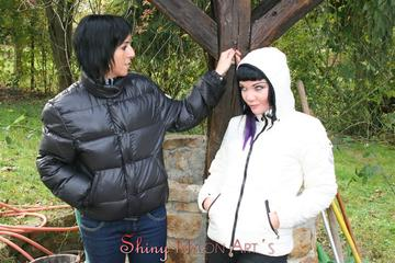 Jill and a black-haired friend of her having fun with eachother outdoor wearing sexy shiny downjackets (Pics)
