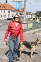 Katharina wearing a shiny nylon down jacket and a jeans while taking her dog out (Pics)