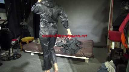 Watching sexy Pia wearing a sexy black shiny nylon jumpsuit reordering rainwear (Video)