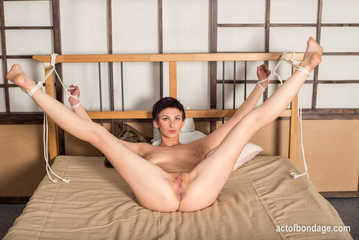 Claudia tied to the bedpost - photos