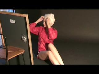 Blonde archive girl wearing sexy shiny nylon shorts and top while posing in a studio (Video)