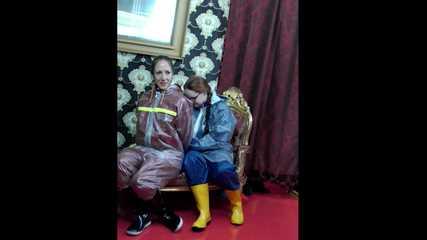 Lady Nadja and Miss Scarlett in  AGU rainwear covered with transparent raingear (video)