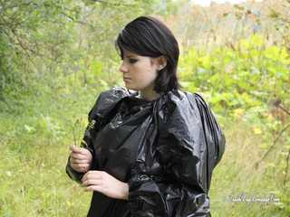 [From archive] Stella is walking in the forest in trash bag dress