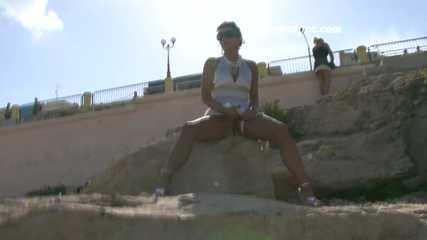 016195 Eve Sits On A Rock To Pee