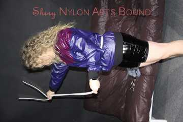 Watching sexy Sophie wearing a supersexy black shiny nylon crazy sensations shorts and a rain jacket ties and gagges herself with ropes, cuffs and a clothgag (Pics)