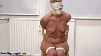 Tied up to the chair with nipple clamps