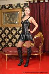 Miss Scarlett bound and gagged in a sexy short latex dress