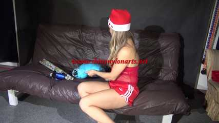 Watching sexy Sandra wearing a sexy red/white santaclause outfit with highheels packing presents (Video