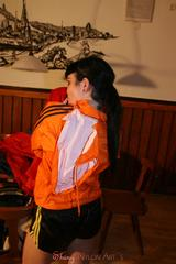 Jill wearing a sexy black nylon shorts and a orange rain jacket while dressing her up (Pics)