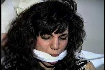 35 YEAR OLD ITALIAN HAIRDRESSER IS CLEAVE GAGGED, MOUTH STUFFED WITH PANTIES, HANDGAGGED, WHILE TIGHTLY TIED TO A CHAIR (D74-14)