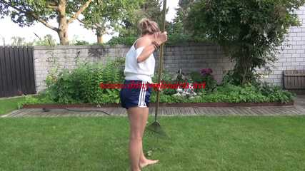 Watching sexy SANDRA wearing a darkblue/white striped  shiny nylon shorts and a top while gardening outdoor (Video)
