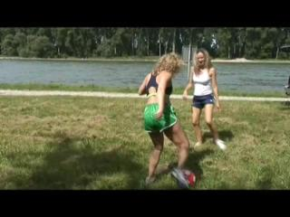 Sophie and Petra playing soccer on a lake wearing sexy shiny nylon shorts and top (Video)