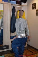 Miss Francine gefesselt und geknebelt in lagenweise Nylon Regensachen und einer silbernen Hotpants