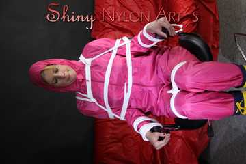 Watching sexy Pia being tied and gagged with ropes and a clothgag on a hairdressers chair wearing a very sexy pink rainwear combination with hood (Pics)