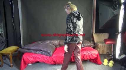 NEW MODELL MIA enjoys the shiny nylon material wearing a sexy brown shiny nylon pants and a black rain jacket (Pics)