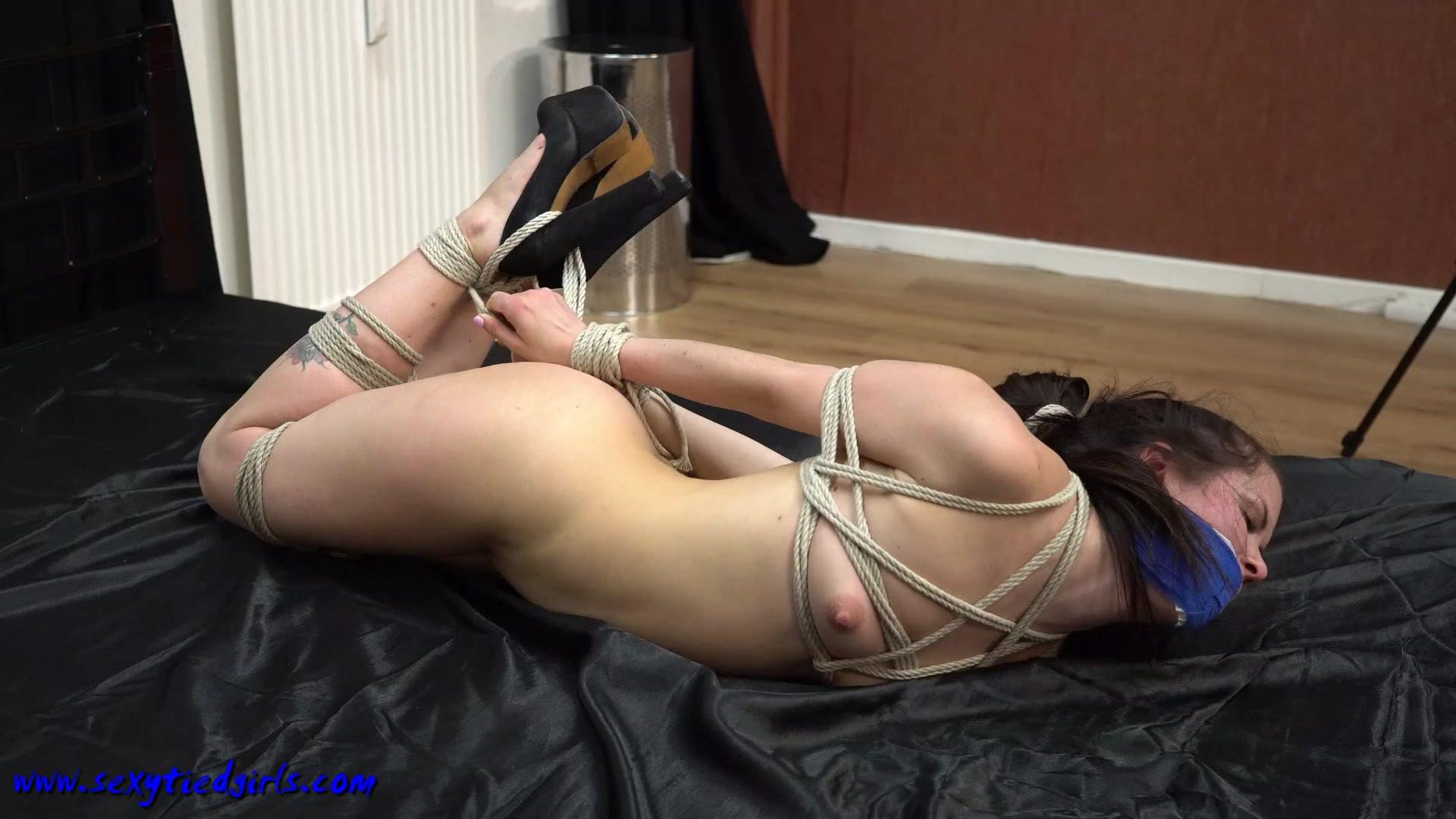 Watch busty party girl duped into bondage