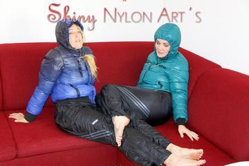 Jill and Sophie making fun and playing with eachother on a sofa wearing sexy shiny nylon rainpants and down jackets (Pics)