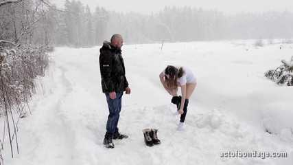 Naked and barefoot Vika tied up in the snow. Part 1