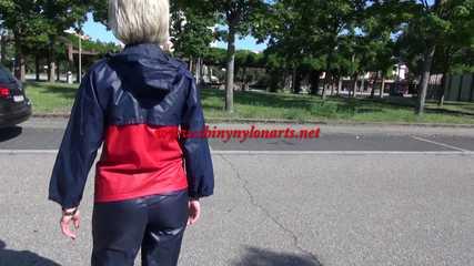 Watching sexy Sonja wearing sexy shiny nylon rainwear walking around the pedestrian area (Video)