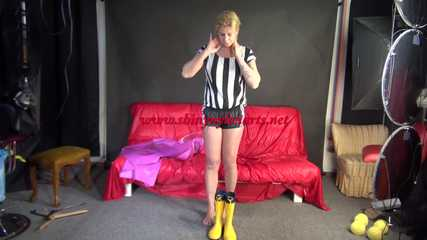 Watching Pia wearing a sexy black shiny nylon shorts, a black/white striped top and yellow rubber boots under her pink rain cape. (Video)
