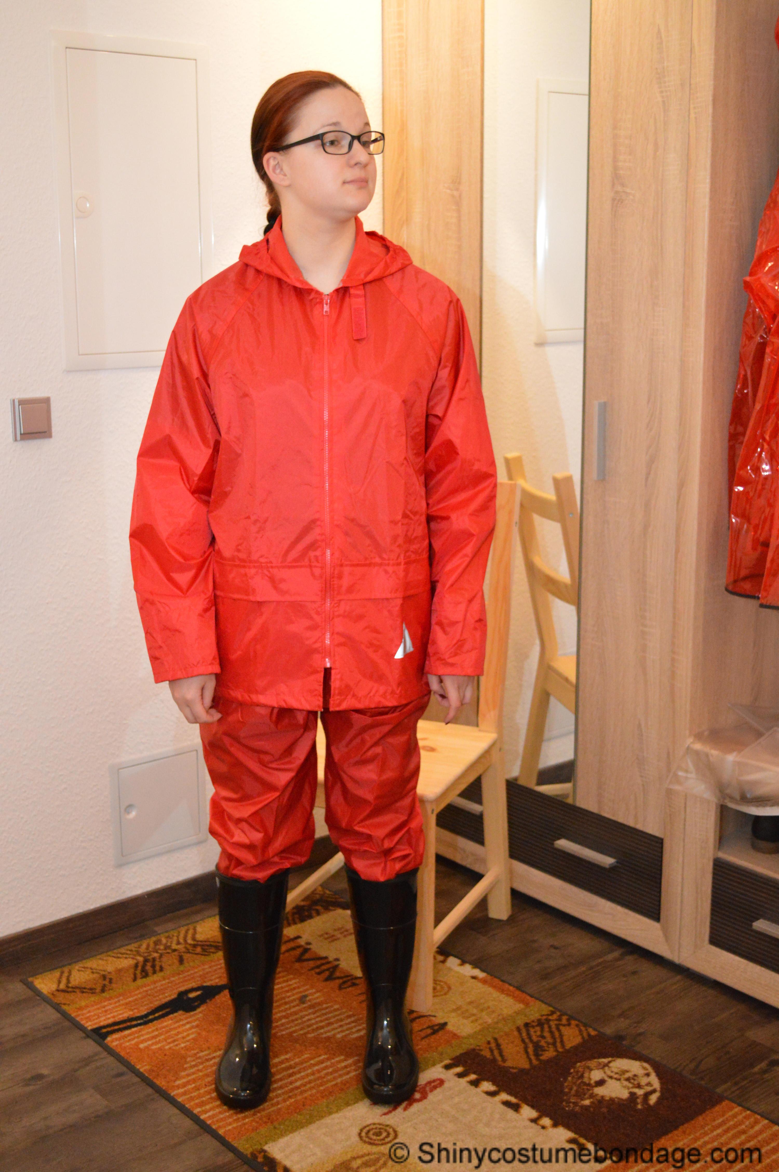 clipspoolcom bondage in red nylon rainwear