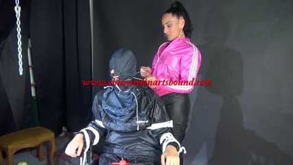 Sexy Ajyana being tied, gagged, hooded and dominated by Stella wearing sexy shiny nylon rainwear on a hairdresser´s chair Part 2 of 2 (Video)