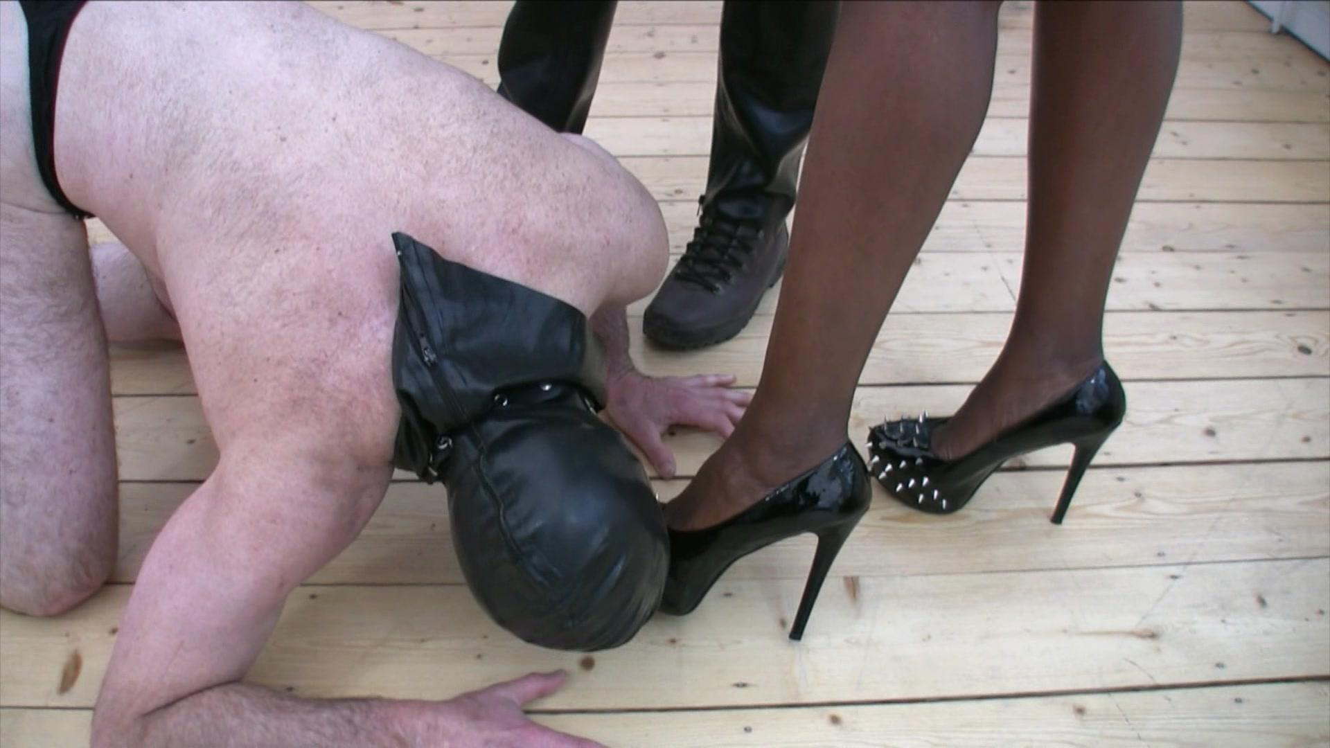Slave in latex gets punished outside