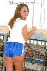 Stella wearing sexy blue shiny nylon shorts with shadow stripes and a top posing outdoor (Pics)